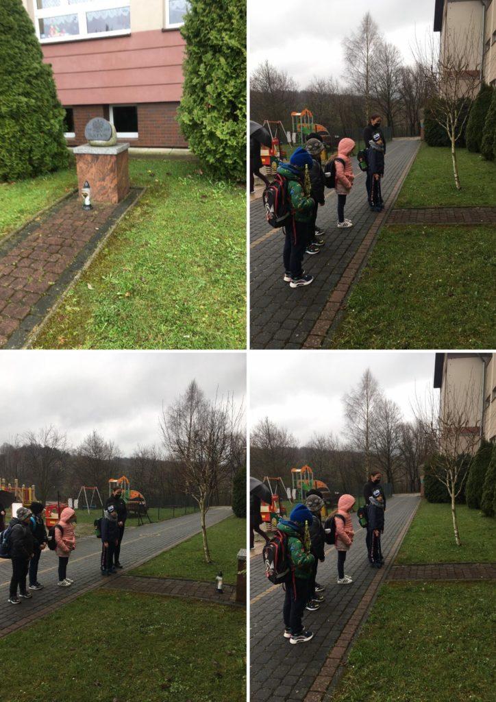 Społeczność szkolna przedpomnikiem